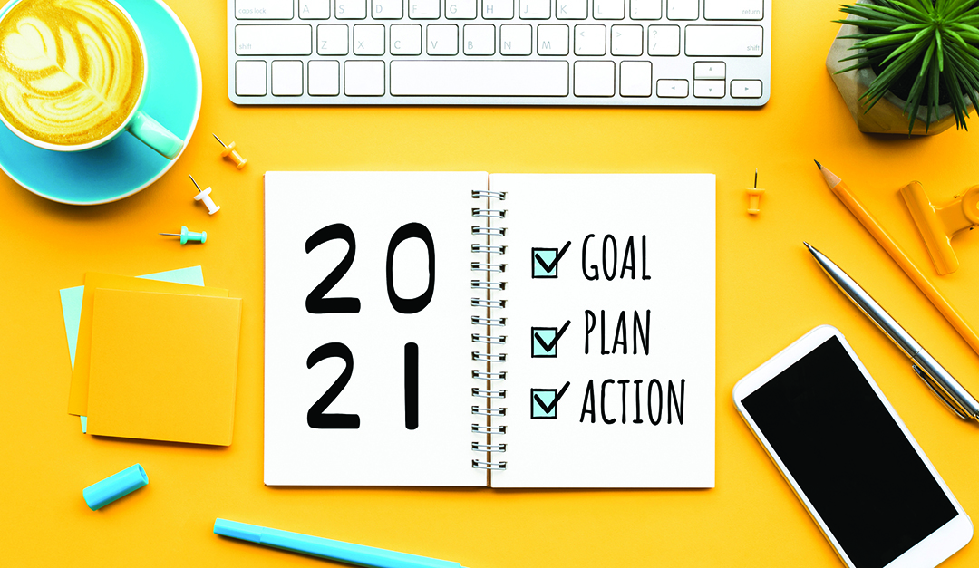 2021 new year goal,plan,action text on notepad with office accessories.Business management,Inspiration concepts ideas